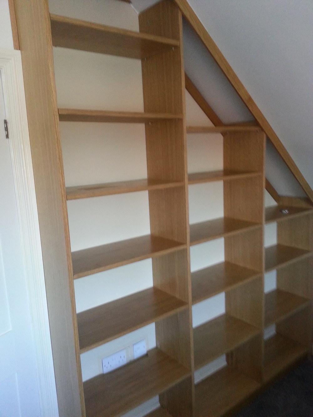 Oak veneer bookcase side-on